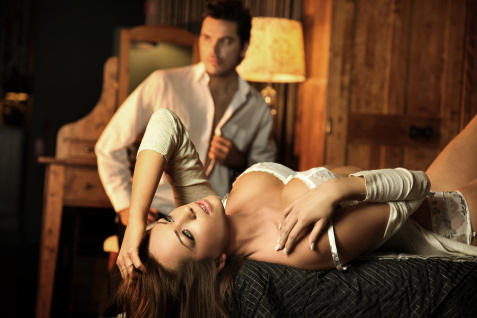 woman in lingerie with man in background